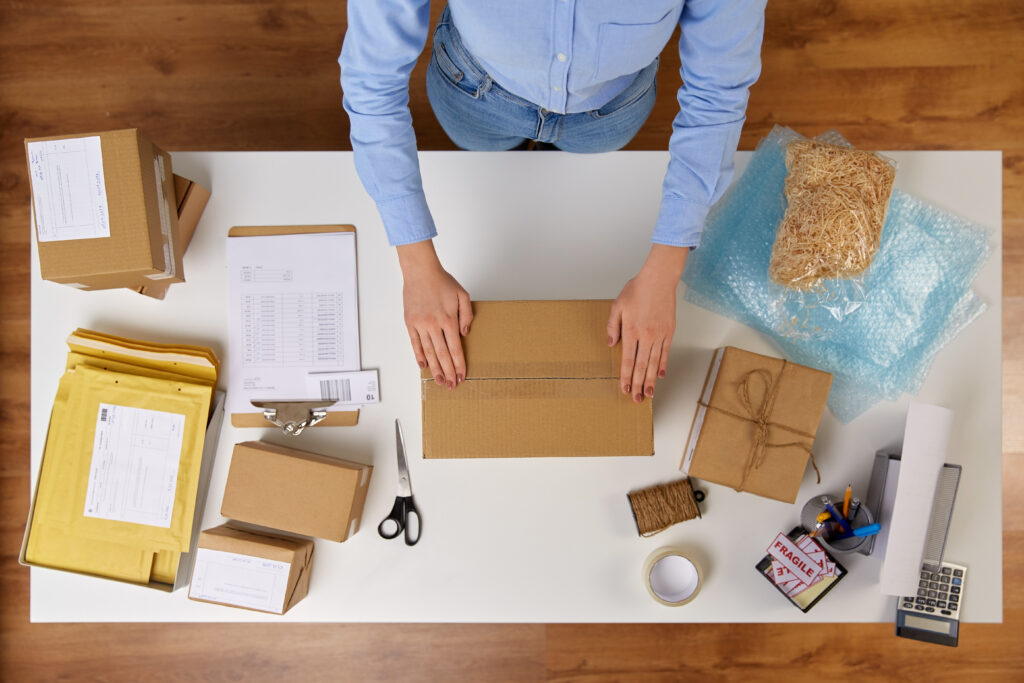 Man at a desk with packaging supplies