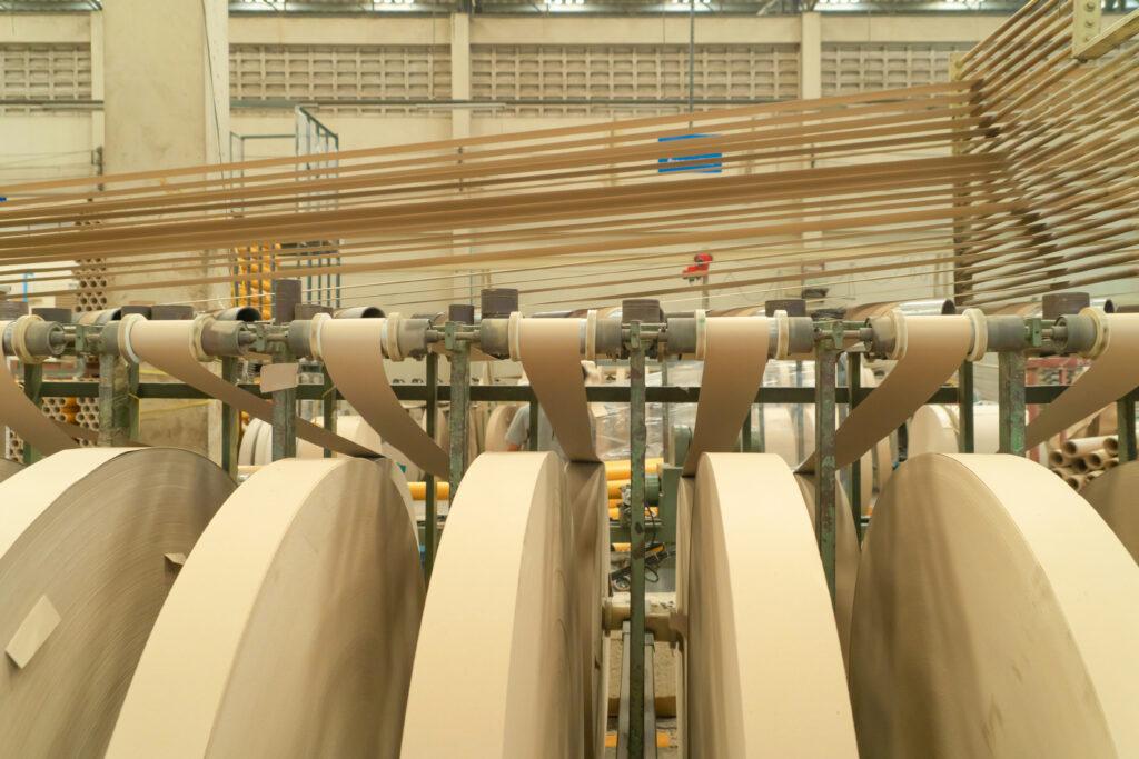 cardboard tubes being manufactured