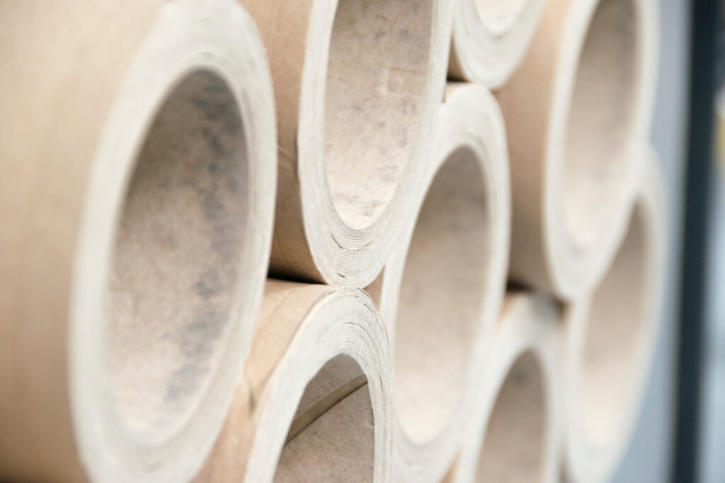 Stack of thick cardboard tubes